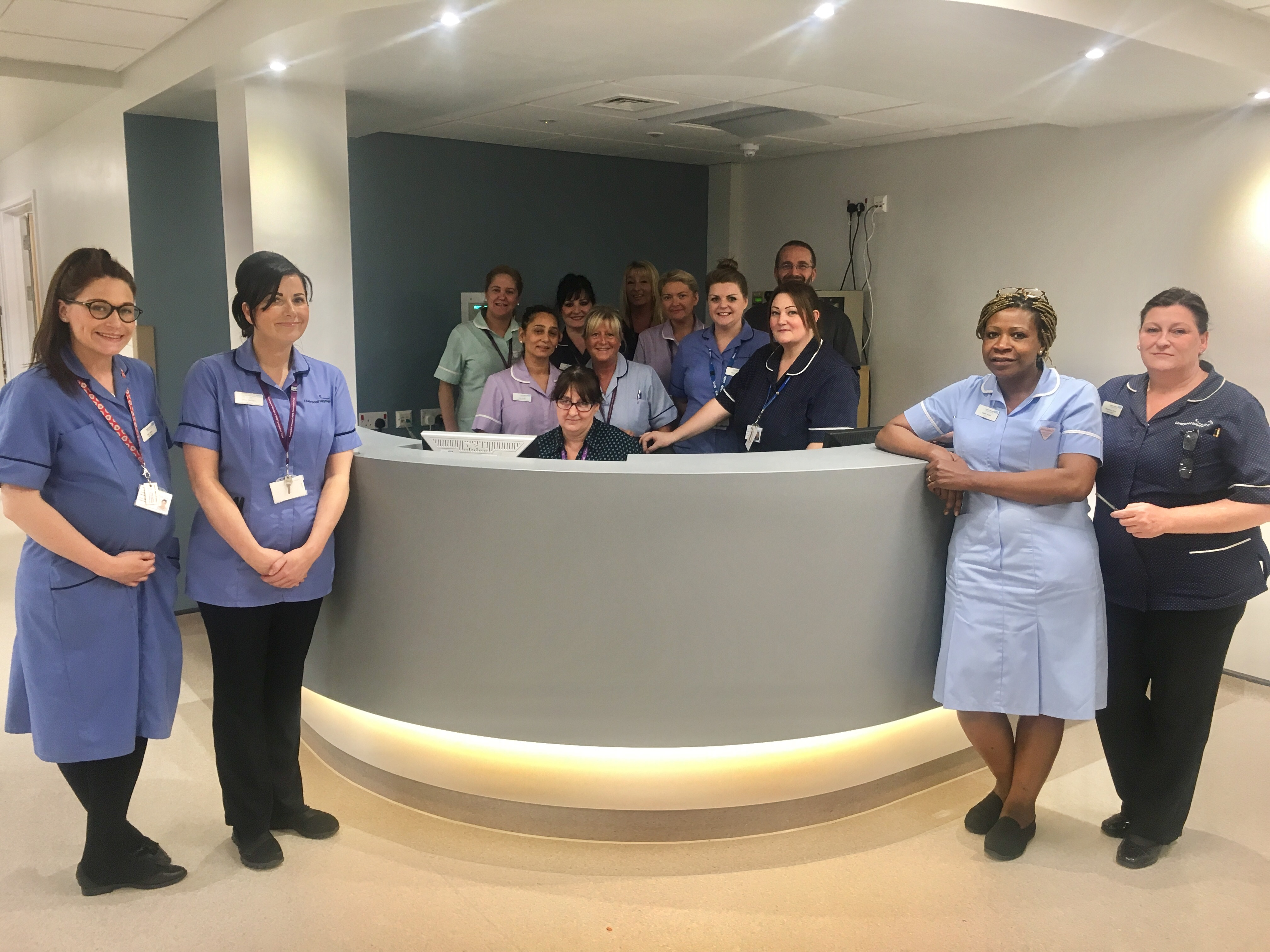 Gynaecology staff members standing in inform around the reception desk